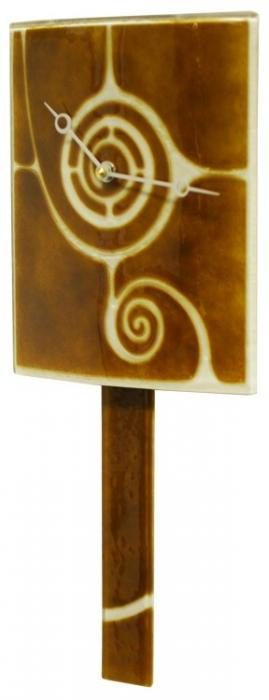 Curved Brown Glass Clock with Pendulum and Swirl Design